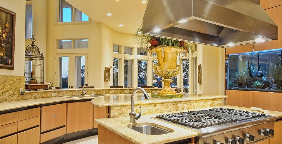 overlooking lake travis in austin texas this grand waterfront property has a gourmet kitchen which opens onto the large living room - Kitchen Gourment