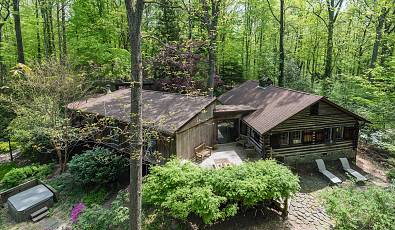 Extraordinary Log Cabin Nestled on a Serene Six Acre Wooded Lot