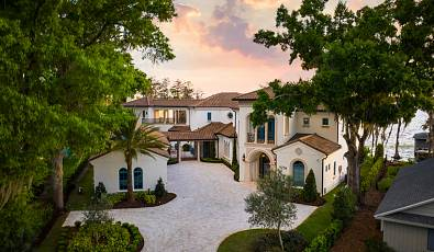 Brand new lakefront home within gated Bay Point, just steps from famed Bay Hill Golf Course